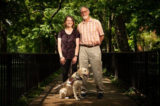 Haley Blankenship and Frank Alexander pose for a portrait with Blankenship's dog, Tasha, on the campus of Vanderbilt University in Nashville on May 22, 2019. Alexander, an orientation and mobility expert, taught Blankenship, who has retinal dystrophy, how to navigate Vanderbilt's campus.