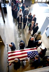 Family and friends follow the casket of longtime Metro employee Charlie Cardwell into the Metro Courthouse on Wednesday, May 22, 2019, where Cardwell will lie in state.