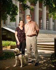 Haley Blankenship and Frank Alexander pose for a portrait with Blankenship's dog Tasha on the campus of Vanderbilt University in Nashville, Tenn., Wednesday, May 22, 2019. Alexander, an orientation and mobility expert, taught Blankenship, who has retinal dystrophy, how to navigate Vanderbilt's campus.