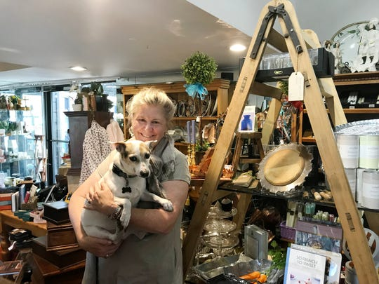 Sassafras Shop owner Anne Whitaker and shop dog Rascal are getting ready to retire.