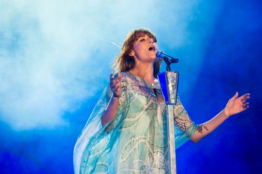 Buda Mendes,  Getty Images RIO DE JANEIRO, BRAZIL - SEPTEMBER 14: Florence Welch of Florence and the Machine performs on stage during a concert in the Rock in Rio Festival on September 14, 2013 in Rio de Janeiro, Brazil. (Photo by Buda Mendes/Getty Images) ORG XMIT: 180463226 ORIG FILE ID: 180591311