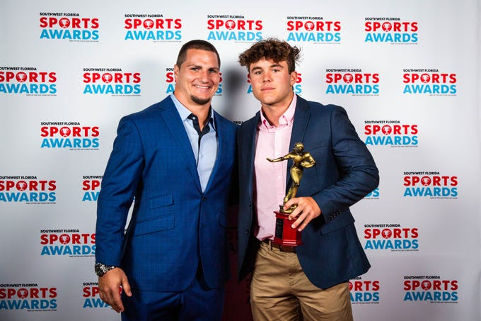 Tommy Bohanon meets with award winners in the VIP room Southwest Florida Sports Awards in Fort Myers on Tuesday May 21, 2019.