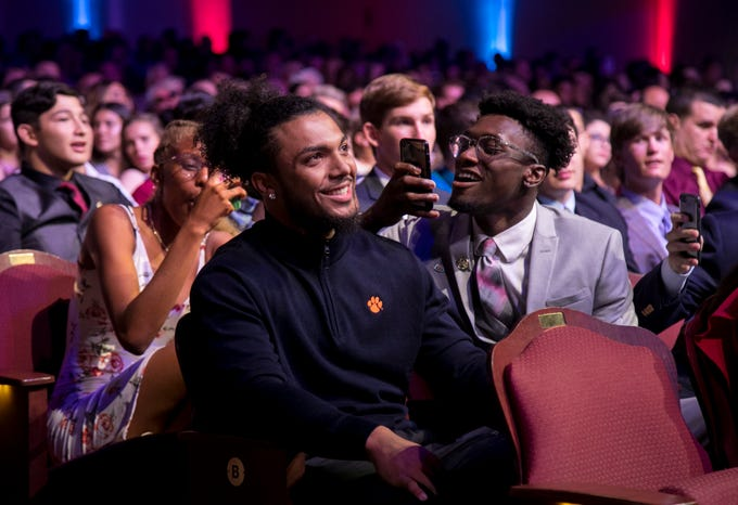 Naples Daily News Offensive Player of the Year Chez Mellusi, center, of Naples High School is cheered on by his friends as his name is announced during the Southwest Florida Sports Awards on Tuesday, May 21, 2019, at Barbara B. Mann Performing Arts Hall in Fort Myers.