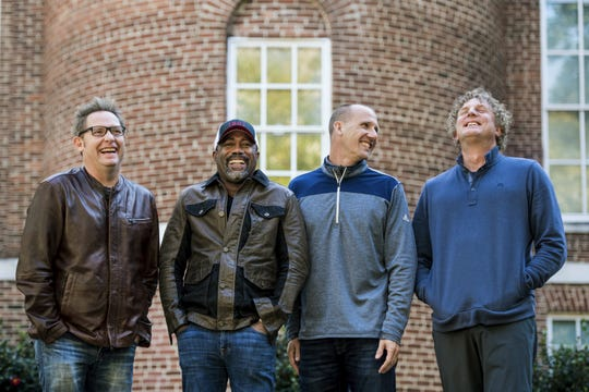 "Dean Felber, left, Darius Rucker, Jim Sonefeld and Mark Bryan of Hootie & the Blowfish gather at the University of South Carolina in Columbia, where they all met.   Sean Rayford/Invision/AP; photo illustration by audrey tate/usa today network In this Nov. 16, 2018 photo, Dean Felber, from left, Darius Rucker, Jim Sonefeld, and Mark Bryan, of Hootie & the Blowfish, pose for a portrait at the University of South Carolina in Columbia, S.C. The band is returning with a tour and album 25 years after ""Cracked Rear View"" launched the South Carolina-based rock band. (Photo by Sean Rayford/Invision/AP)"