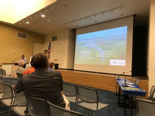 Residents gather at the South Regional Public Library on Tuesday, May 21, to hear about Collier County's plan to restore some of the natural flowways through the county and balance freshwater flows into Naples and Rookery bays.