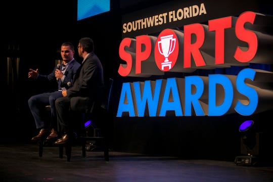NFL fullback and North Fort Myers High School graduate Tommy Bohanon is interviewed by Ed Reed onstage at the Southwest Florida Sports Awards at Barbara B. Mann Performing Arts Hall.