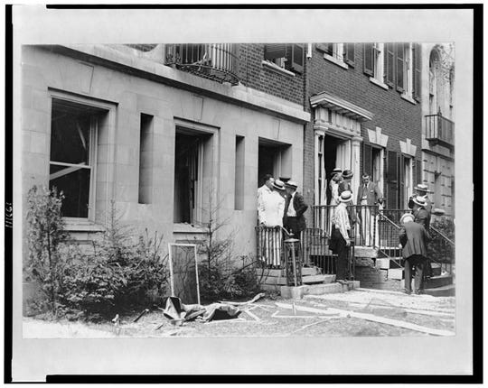 Investigators in the front of Mitchell Palmer's house after the bombing. 1919