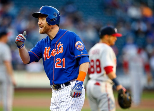 New York Mets third baseman Todd Frazier (21) reacts after hitting a single in the second inning against the Washington Nationals at Citi Field on May 21, 2019.