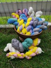Skeins of brightly dyed alpaca yarn, produced by Humor Me Farm, of Newfoundland.