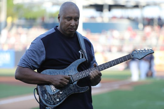 Former New York Yankees star Bernie Williams plays the national anthem on his guitar prior to the game between the New York Yankees and Philadelphia Phillies at George M. Steinbrenner Field in Tampa, Fla., on March 13, 2019.