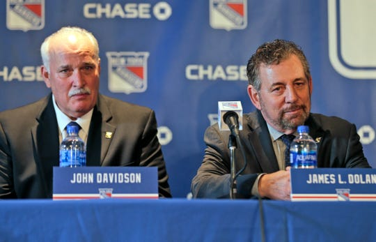 John Davidson, left, and James Dolan, owner of the New York Rangers, participate in a news conference in New York, Wednesday, May 22, 2019. Davidson was hired as team president Friday, hours after leaving his post with the Columbus Blue Jackets. He returns to New York where he spent parts of eight seasons as a Rangers goaltender and was a TV analyst for almost a decade.