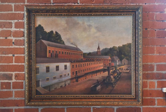 "Close up photo of the recently purchased, 19th century painting of the Swinburne works featuring the 1948 ""Victory"" loco, photographed at Paterson Museum."