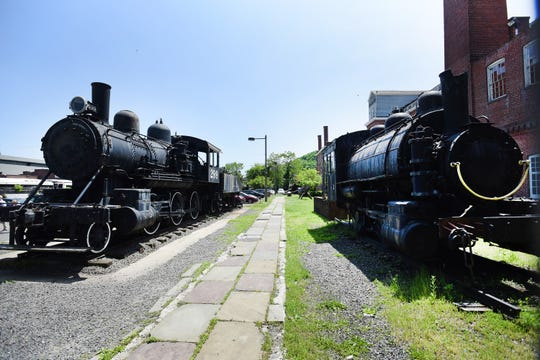 The new foundation's next project will be erecting a open-air metal canopy around the two train locomotives outside the building to help preserve and protect them, photographed at Paterson Museum on 05/22/19.