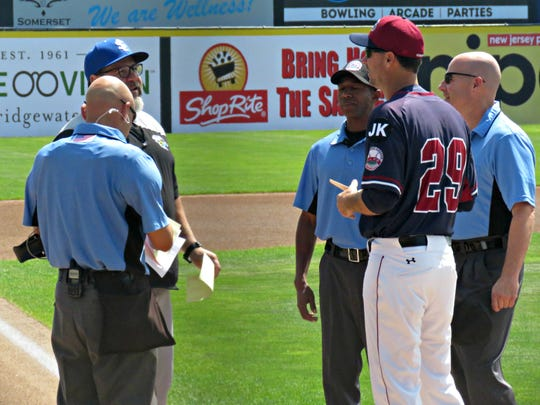 Skeeters manager Pete Incaviglia and Patriots manager Brett Jodie exchanging the lineup cards before Wednesday's game.