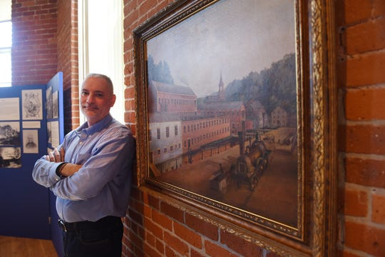"Story about the newly formed Paterson Museum Foundation, a nonprofit entity designed to raise money to add to the collections at the museum. Photo of Jack DeStefano, Museum Director, standing next to the recently purchased, 19th century painting of the Swinburne works featuring the 1848 ""Victory"" loco, photographed at Paterson Museum on 05/22/19."