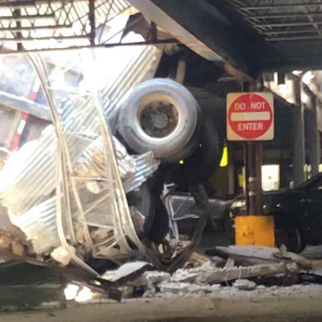 Dump truck falls through North Bergen parking garage