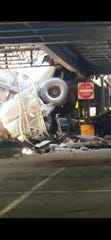 A truck fell through the top level of a parking garage in North Bergen