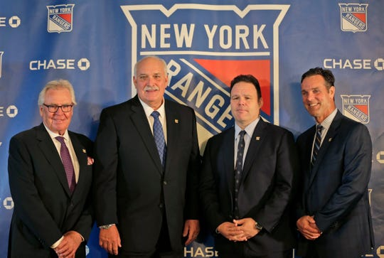 John Davidson, the new president of the New York Rangers, second from left, poses for a picture with adviser to the owner, Glen Sather, left, general manager Jeff Gorton, second from right, and coach David Quinn during a news conference in New York, Wednesday, May 22, 2019. Davidson was hired as team president Friday hours after leaving his post with the Columbus Blue Jackets. He returns to New York where he spent parts of eight seasons as a Rangers goaltender and was a TV analyst for almost a decade.