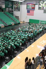 Members of the Farmington High School Class of 2019 gather in Scorpion Arena prior to their May 21 commencement ceremony at Hutchison Stadium.