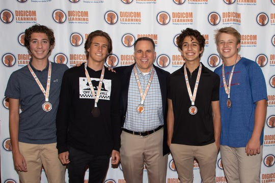 Gavin Muro, Jeffrey Kastner, Alec MacMillan, and Charlie McCarthy are accompanied by their teacher Gary Wise (center) to the Digicom Film Festival. May 17, 2019.