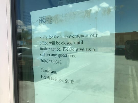 A sign posted on the door of the Health to Hope Clinics' location at the Coachella Valley Rescue Mission on Sunday, May 19, 2019.