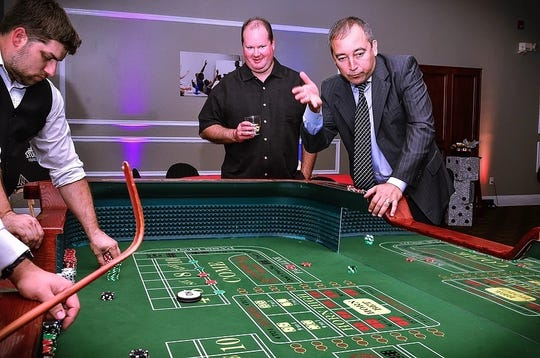 Guests give their luck a try at the Betting Big on Kids Casino Night in 2018. The third annual event will be held June 22 at DeLuna Winery to raise funds for Mr. Robbins' Neighborhood programs.