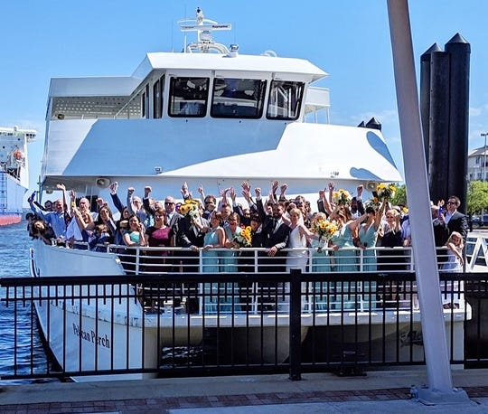 A wedding celebration takes place on a Pensacola Bay Cruises ferry.