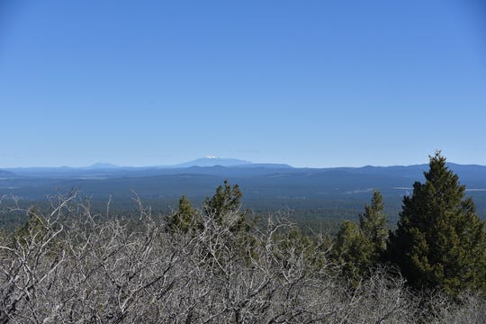 Views from the Baker Butte fire tower catwalk stretch from Flagstaff to Tucson.