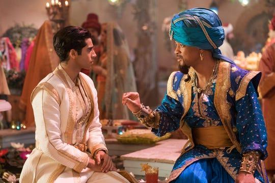 "Genie (Will Smith) gives advice to Aladdin (Mena Massoud) in ""Aladdin."""