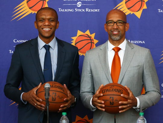 General manager James Jones (left) poses with Monty Williams, the new head coach of the Phoenix Suns during a press conference on May 21, 2019 at Talking Stick Resort Arena in Phoenix, Ariz.