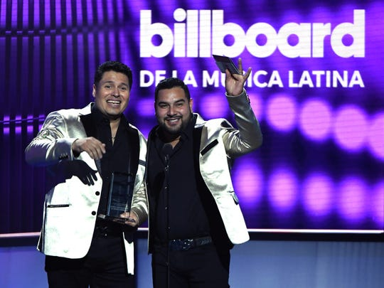 Oswaldo Silvas Carreon (L) and Alan Manuel Ramirez Salcido of Banda MS Banda Sinaloense MS de Sergio Lizarraga accept the Regional Mexican Artist of the Year, Duo or Group award during the 2019 Billboard Latin Music Awards at the Mandalay Bay Events Center on April 25, 2019 in Las Vegas, Nevada.