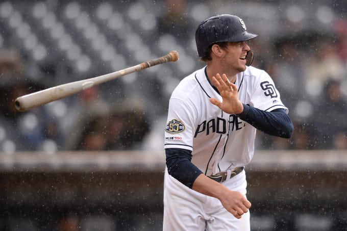 May 22, 2019; San Diego, CA, USA; San Diego Padres left fielder Wil Myers (4) hits a single during the fourth inning against the Arizona Diamondbacks at Petco Park. Mandatory Credit: Orlando Ramirez-USA TODAY Sports