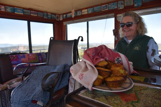 Shirley Payne offers fresh-baked muffins to tower visitors.