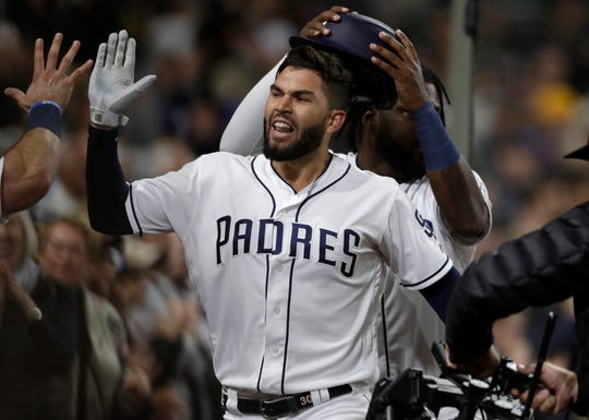 San Diego Padres' Eric Hosmer is congratulated by teammates after hitting a two-run home run during the sixth inning of the team's baseball game against the Arizona Diamondbacks, Tuesday, May 21, 2019, in San Diego.