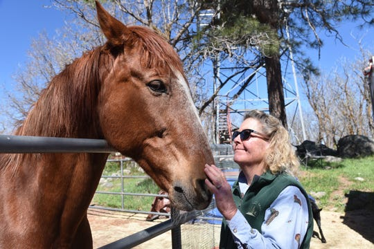 Fire lookout Shirley Payne and her horse Rameses.
