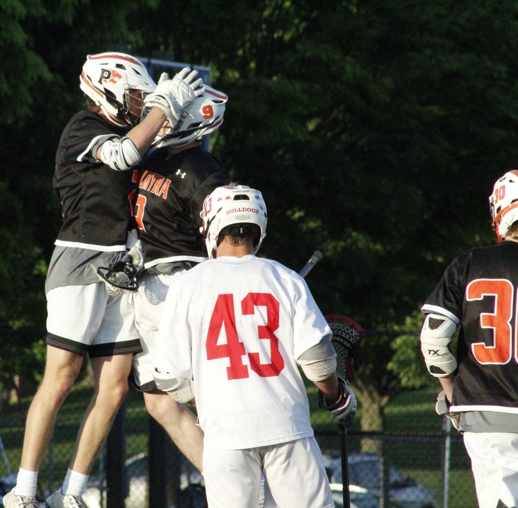 Kyle Wasilewski and Grant Haus celebrate after collaborating on a Haus goal. Together they scored eight goals.