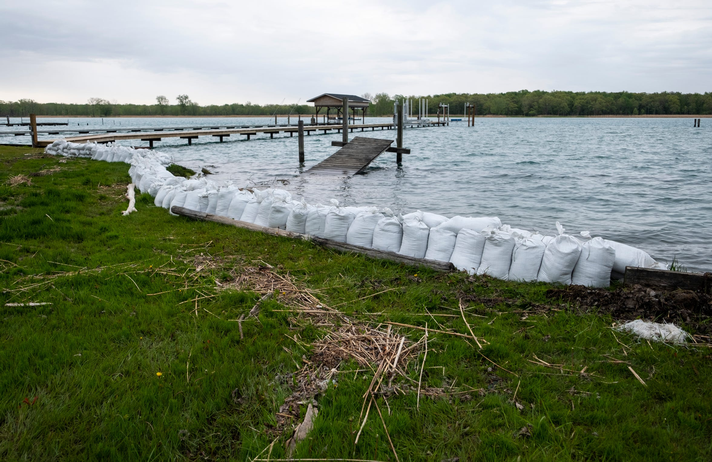 Sandbags are seen stacked along the St. Clair River in Harsens Island Wednesday, May 22, 2019. Harsens Island residents are being asked to reduce water consumption to prevent in preparation for rising water levels.