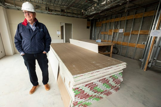 Lee Stevens, Stevens Architects principal architect and project developer, is pictured in the living room of a one-bedroom unit on the third floor of the Bluewater View condos Wednesday, May 22, 2019 in downtown Port Huron.