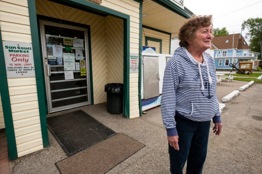 "Peggy Prather is pictured outside of San Souci Market Wednesday, May 22, 2019 on Harsens Island. Prather has lived on the island for 60 years, and although she's seen worse flooding, she says the rising water is still ""the main source of gossip right now."""