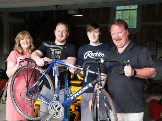 From left, Cintdy, Ryan, Kyle and Jim Wilson at their home in the Town of Poughkeepsie on May 20, 2019. Ryan has decided to ride this bicycle to Miami, Florida to raise money for ALS research.
