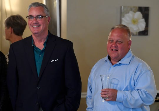 Incumbent Chris Reilly, left, and challenger Ron Smith share a laugh while waiting for the election results to be posted, Tuesday, May 21, 2019.