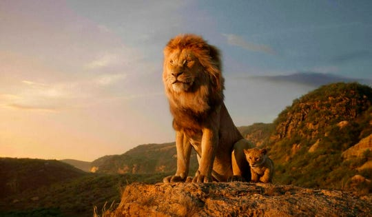 "This image released by Disney shows the characters Mufasa, voiced by James Earl Jones, left, and Simba, voiced by JD McCrary, in a scene from ""The Lion King,"" directed by Jon Favreau."