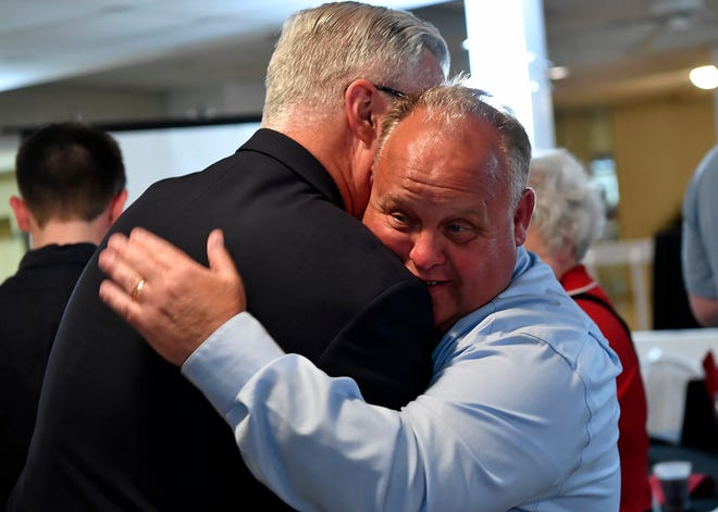 Outgoing incumbent Commissioner Chris Reilly, left, hugs Ron Smith after Smith secured the second Republican nomination behind Julie Wheeler, Tuesday, May 21, 2019.John A. Pavoncello photo