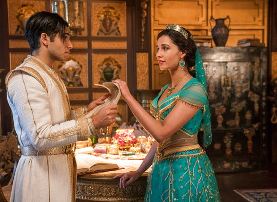 """Mena Massoud as Aladdin, left, and Naomi Scott as Jasmine in Disney's live-action adaptation of the 1992 animated classic """"Aladdin."""" The movie opens Thursday at Regal West Manchester, Frank Theatres Queensgate Stadium 13 and R/C Hanover Movies."""