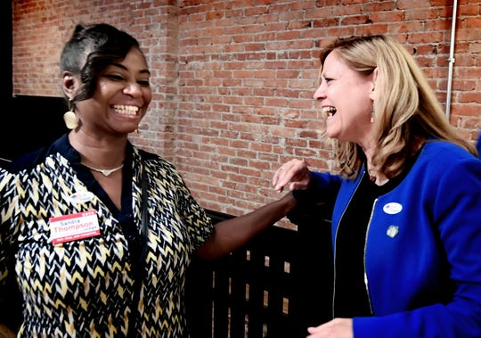 York County Court of Common Pleas candidate Sandra Thompson, left, talks with York County Commission candidate Judith Higgins during a watch party at Rockfish Public House in York City Tuesday, May 21, 2019. Bill Kalina photo