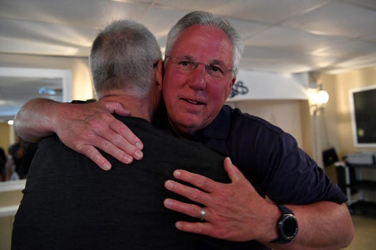 Incumbent Sheriff Richard Keuerleber gets a hug after winning the primary, Tuesday, May 21, 2019.