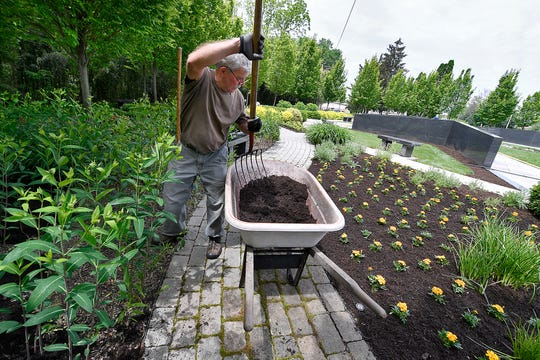 Mike Stebbins from Stebbins & Company mulches the Veterans Memorial Gold Star Healing & Peace  Garden on Vander Avenue for Memorial Day, Wednesday, May 22, 2019.