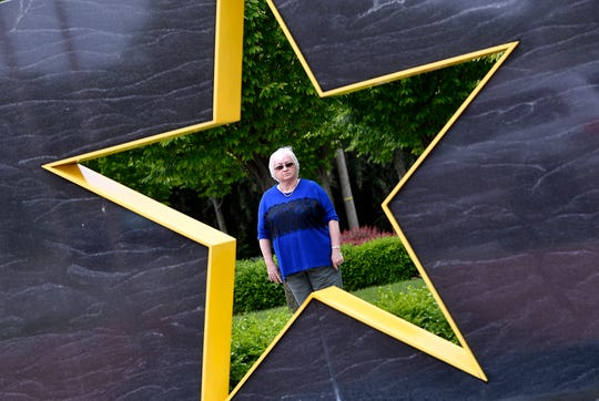Gold Star mother Cher Kondor, who's son Martin was killed in action in Iraq in 2004, stands in the Veterans Memorial Gold Star Healing & Peace Garden which she was instrumental in creating. 