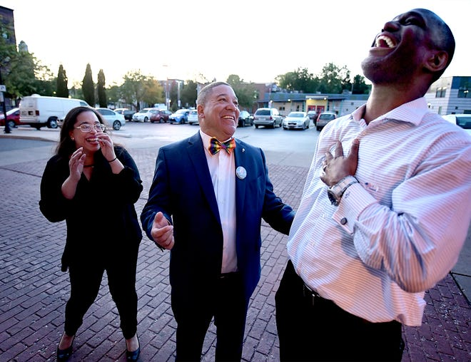 York City Council candidate Lou Rivera, center, jokes with supporter Fred Walker and incumbent West York Borough Council candidate Mildred Tavarez Sandie Walker during a watch party at Mi Caldero restaurant in York City Tuesday, May 21, 2019. Bill Kalina photo