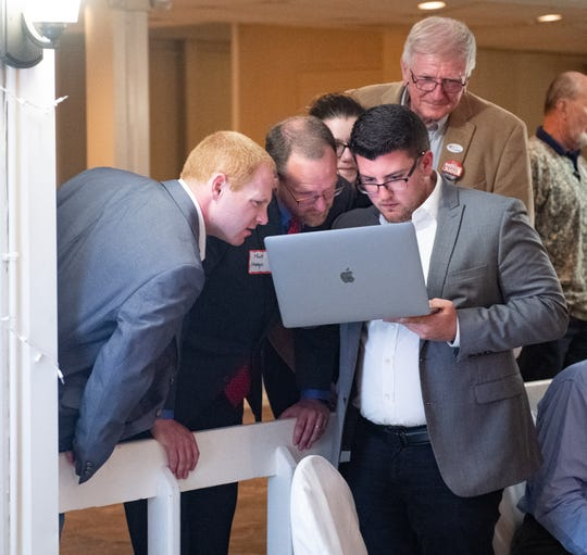 Matt Menges and his supporters look at the live feed on primary night at a gathering of the Republican Party of York County. Menges won the party's nomination for York County Court of Common Pleas judge.
